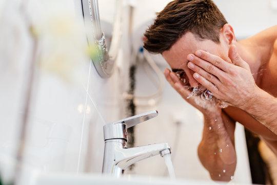 Man washing face in morning