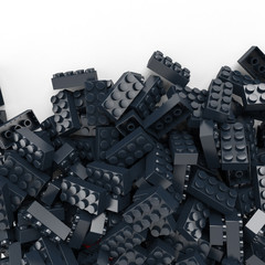 toy plastic bricks background in navy blue
