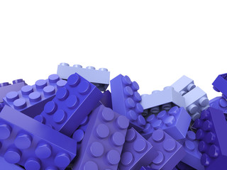 toy plastic bricks background in lilac