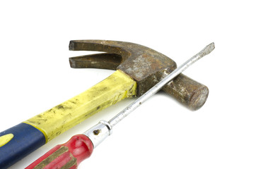 cropped image, rusty hammer and screwdriver isolated on white background