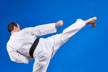 Blow leg in the performance of an athlete with a black belt