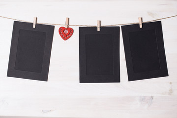 Cards and heart hanging on a rope hitched clothespins.