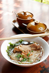 Rice noodle soup with stewed chicken and chinese herbs