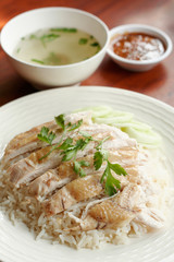 Steamed chicken with rice, soup, and spicy sauce