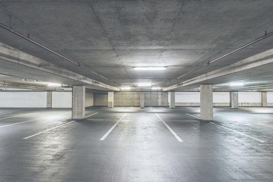 scene of empty cement Parking Garage interior in the mall.