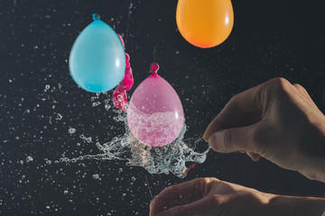 Popping water balloon / highspeed image