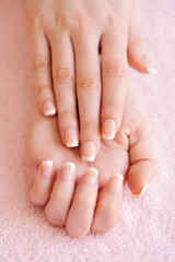 Foto op Canvas Manicure Woman hands with beautiful french manicure