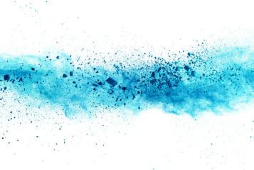 Explosion of blue powder on white background