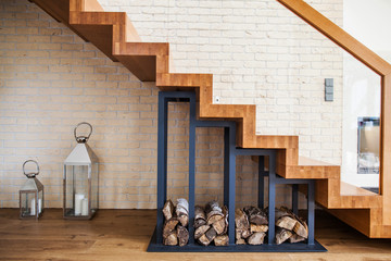 Photo on textile frame Stairs modern solution to storage pile of wood under the stairs at home