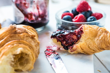 Fresh croissant with berry jam