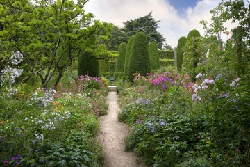 English country garden with clipped yew trees