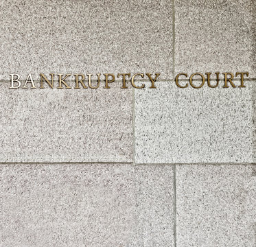 bankruptcy court sign in square format on granite