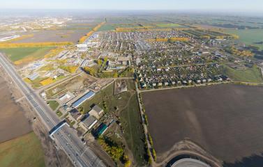 Aerial road interchange, viaduct. Crossroads view parking lots, bridges. Copter shot. Panoramic image.