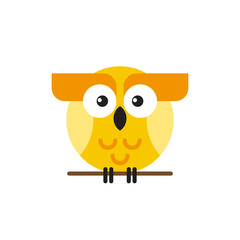 Cute yellow bright owl sitting on a tree branch.
