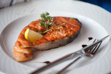 Grilled humpback salmon with a lemon slice