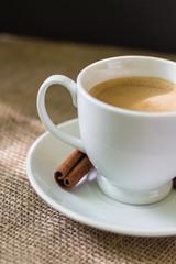 Coffee mug with cinnamon stick.