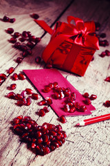 Valentine's Day composition: gift in a red package tied with a r