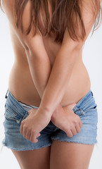 Torso of Topless Woman in Jean Shorts