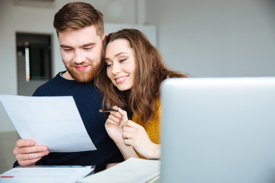 Couple managing their bills at home