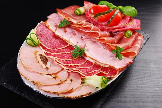 platter of sliced ham,salami and cured meat