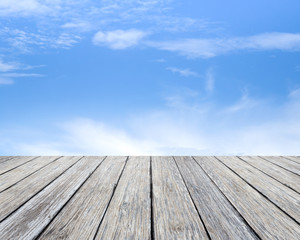 Wood table top on blue sky background  - used for display your products
