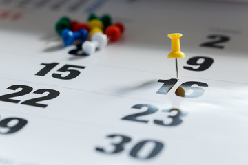 Pushpins on calendar, Busy and overworking days. Important date