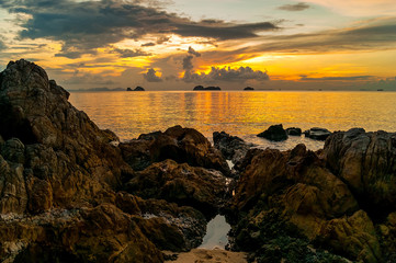 Sunset over sea, cliffs and stones and islands background on a tropical island Koh Samui, Thailand
