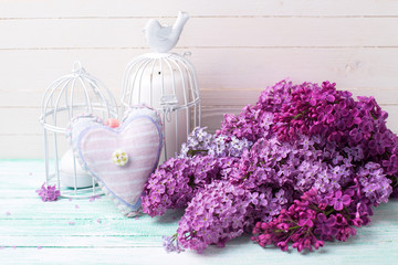 Background  with fresh lilac flowers, decorative heart  and cand