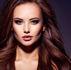 Face of the beautiful sexy woman with long brown hair