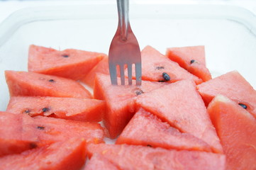 slices of watermelon with fork