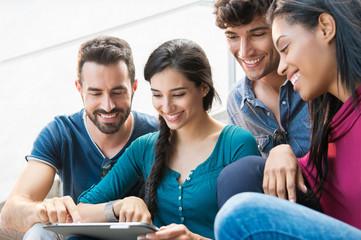 Friends using digital tablet