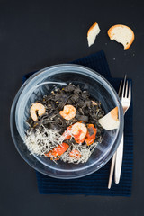 Black squid ink tagliatelle with tomatoes and shrimps