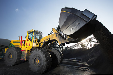 Front end loader dumping dirt in construction site