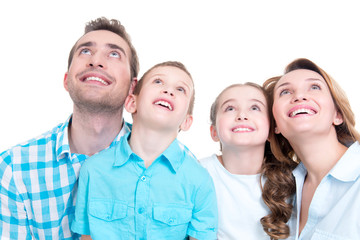 Happy family with two children looking up