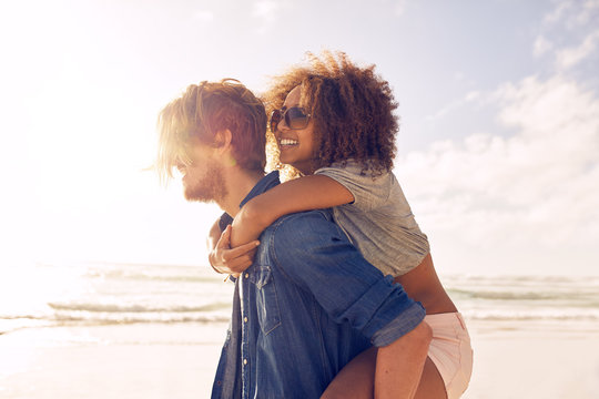 Young couple enjoying their summer vacation on beach