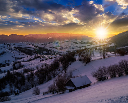 rural area in mountains at sunset