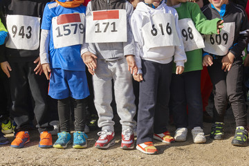 Athletic children ready to start a cross country race. Outdoors