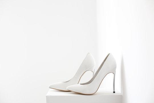 Elegant bride white shoes on isolated background