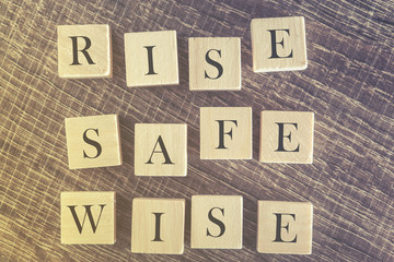 Rise Safe Wise message formed with wooden blocks
