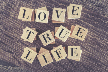 Love True Life words formed with wooden blocks