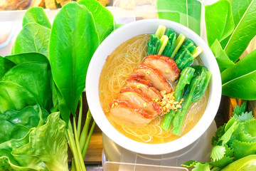 Noodles soup with pork and vegetable chinese style - Fake dish of asian vermicelli soup with salad decoration in showcase as an example for demonstration