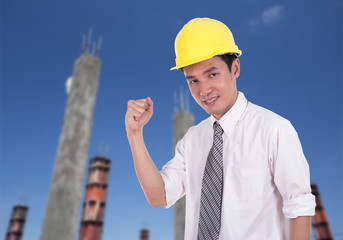 Happy engineer with arm raised, concept of successful, construct