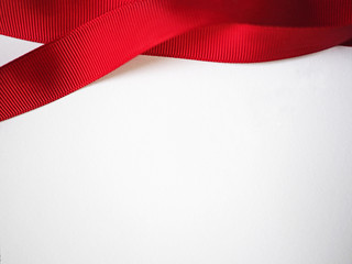 Red ribbon on white paper for background