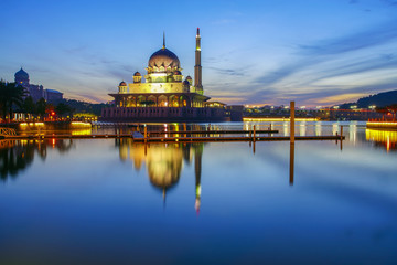 Beautiful reflection of Putra Mosque in the lake during blue hour