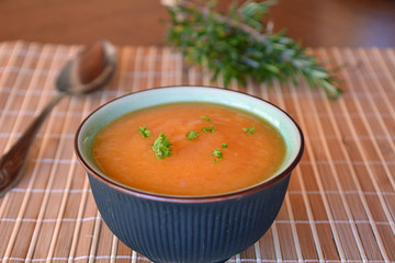 Creamy Butternut Squash Soup In Ceramic Bowl On A Table