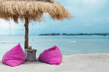 Sunbed and umbrella on a tropical beach - Stock image