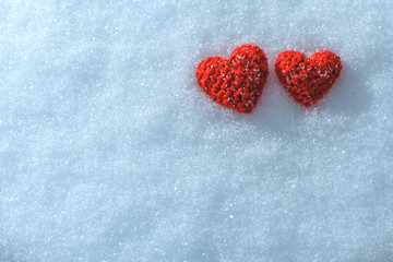 The knitting heart on a snowy background. Greeting card for Vale