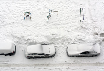 Cars parked in snow.