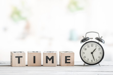 Alarm clock on a wooden desk