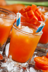 Fresh cold carrot juice with ice, selective focus